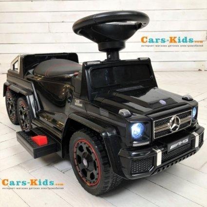 Электромобиль-каталка Mercedes-Benz G63 AMG 6x6 черный (педаль газа, музыка, свет фар, резиновые колеса, мягкое сиденье)