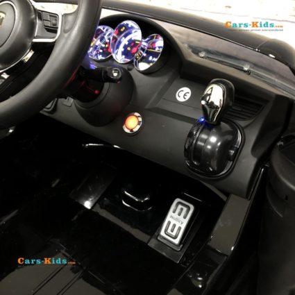 Электромобиль Porsche Cayenne SX1688 MP4 черный (сенсорный дисплей, легкосъемный аккумулятор, колеса резина, кресло кожа, пульт, музыка)
