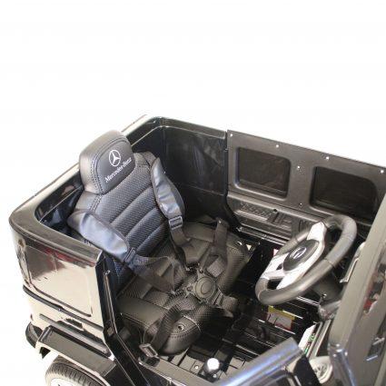 Электромобиль Mercedes-Benz G63 T999TT черный (кресло кожа, колеса резина, пульт, музыка)